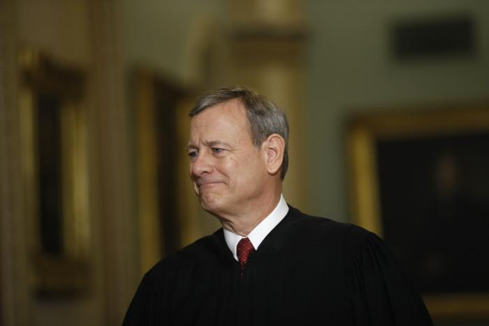 Chief Justice of the United States, John Roberts walks to the Senate chamber at the Capitol in Washington.