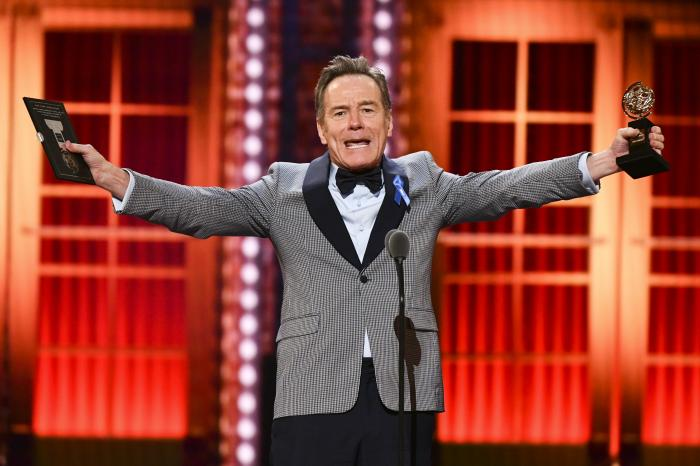 """Bryan Cranston accepts the award for best performance by an actor in a leading role in a play for """"Network"""" at the 73rd annual Tony Awards."""