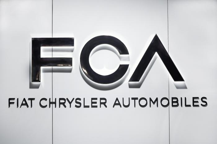 In this Monday, Jan. 14, 2019 file photo, Fiat Chrysler Automobiles FCA logo is shown at the North American International Auto Show in Detroit