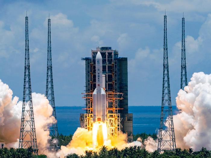 In this July 23, 2020, file photo released by China's Xinhua News Agency, a Long March-5 rocket carrying the Tianwen-1 Mars probe lifts off from the Wenchang Space Launch Center in southern China's Hainan Province