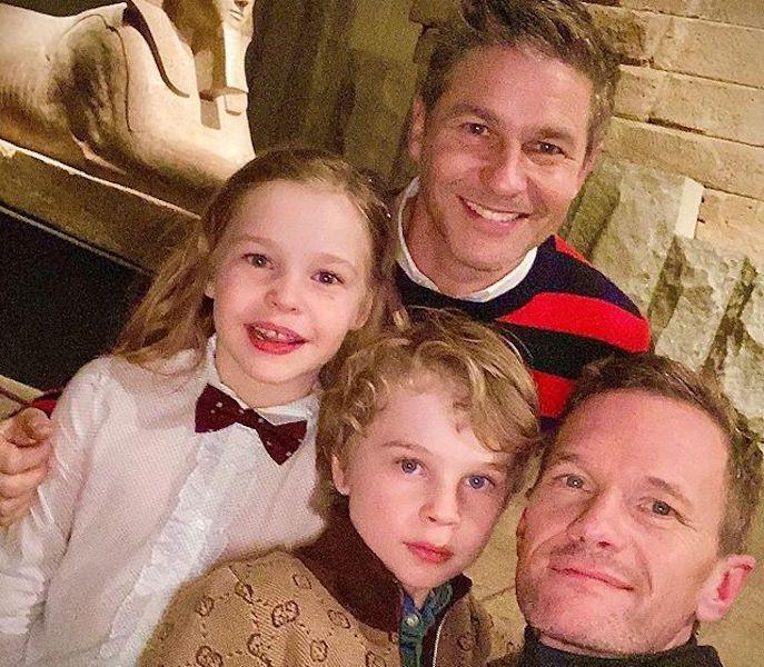 David Burtka, back, with Neil Patrick Harris, right, and their two children, Harper Grace, left, and Gideon Scott, center.