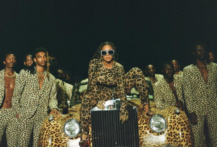 "Beyonce, center, in a scene from her visual album ""Black is King."