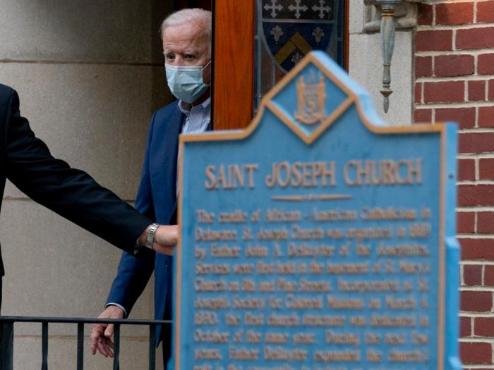 In this Oct. 3, 2020, file photo Democratic presidential candidate former Vice President Joe Biden leaves St. Joseph Catholic Church in Wilmington, Del.