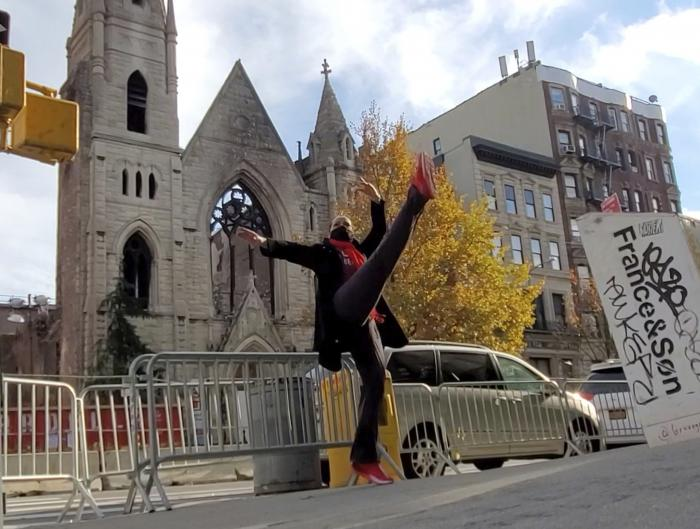 Professional dancer Adrienne Hurd performs in front of the facade of New York City's 128-year-old Middle Collegiate Church