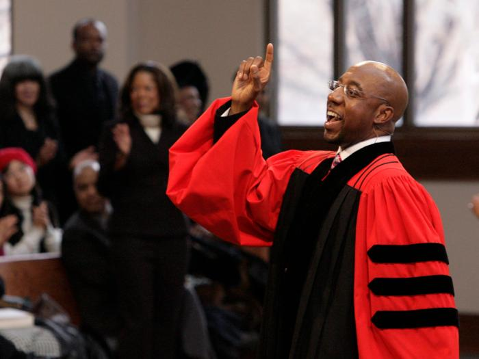 In this Sunday Jan. 18, 2009 file photo, Rev. Raphael Warnock delivers a sermon during a church service at Ebenezer Baptist Church in Atlanta