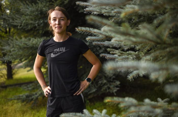 University of Montana cross country runner Juniper Eastwood posing for a photo at Campbell Park in Missoula, Mont.