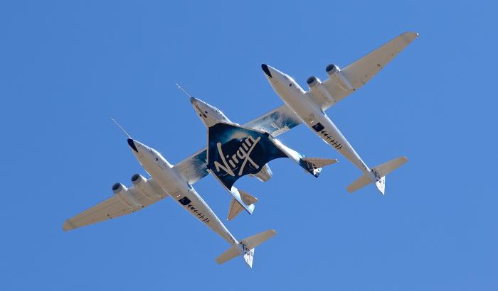 In this Thursday, Feb. 13, 2020 file photo, Virgin Galactic's VSS Unity departs Mojave Air & Space Port in Mojave, Calif.
