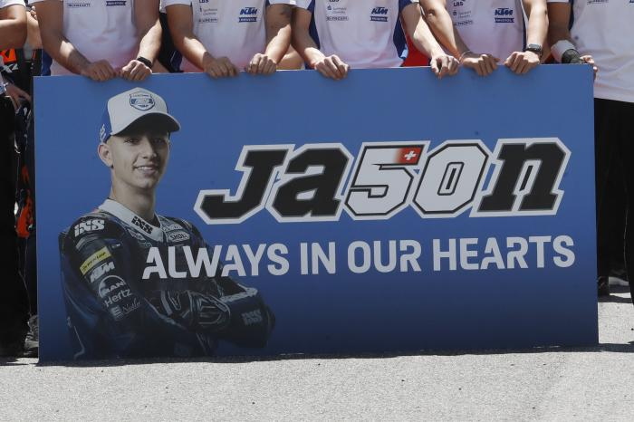 Teammates of 19 years-old Swiss pilot Jason Dupasquier pay a minute of silence in his memory prior to the start of the Motogp Grand Prix of Italy at the Mugello circuit, in Scarperia, Italy, Sunday, May 30, 2021.