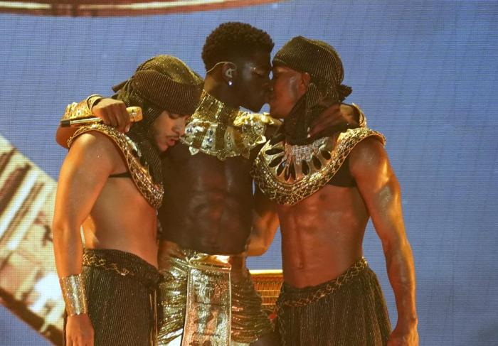Lil Nas X, center, kisses a dancer at the conclusion of his performance at the BET Awards on Sunday, June 27, 2021, at the Microsoft Theater in Los Angeles.
